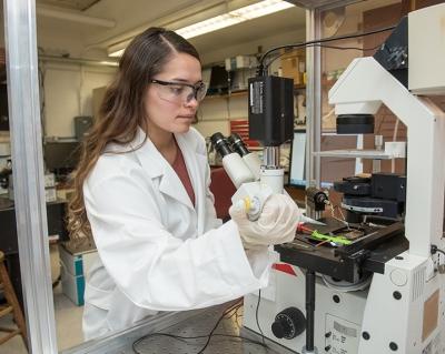 Engineering researcher Alexandria Trevino operating equipment